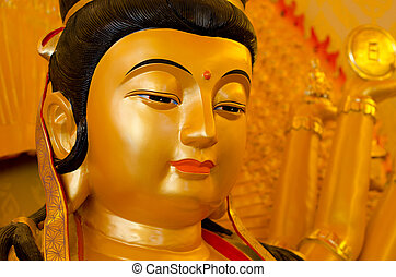 Kuan yins face statue