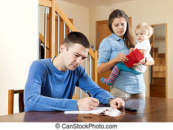 Financial problems in family. Sad woman wit baby against...