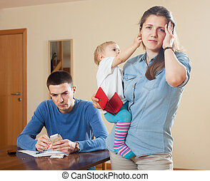 Man and wife having problems - Man and wife with baby having...