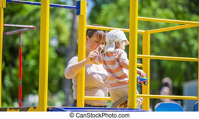 Mother And Child On the Playground