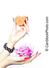 Pink rose and soap with hands