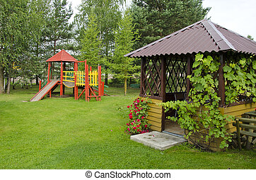 wooden children playground in summer park - wooden children...