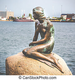 The Little Mermaid is a bronze statue by Edvard Eriksen,...