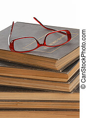 reading glasses on a stack of books - reading glasses...