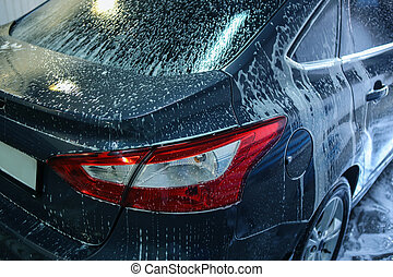 car in penalty fee on car wash - blue car on car wash in...