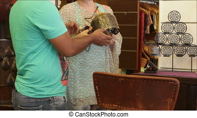 woman chooses decorative accessories in the store with a man