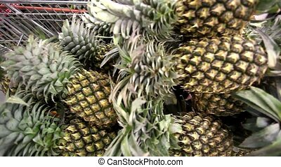 Full shopping carts of pineapple in a supermarket Thailand Koh Samui