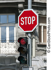 Red traffic light. - Red traffic light on and stop sign.