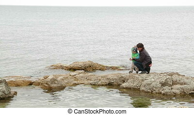 Mother And Baby At the Seaside In Autumn