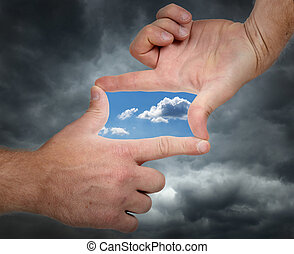 vision of change - holding hands up and seeing a vision of a...