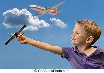 Boy dream of pilot - A boy holding a plane up dreaming of...