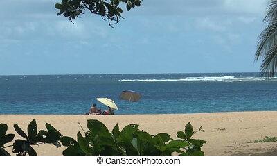Relaxing at romantic beach on Kauai Island,Hawaii