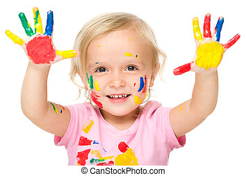 Portrait of a cute little girl playing with paints -...
