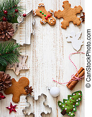 Christmas background with gingerbread,cookies cutters,fir...