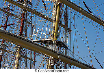 Masts - Sail ship masts with blue sky background