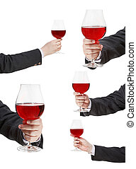 set of red wine glass in businessman hand isolated on white...