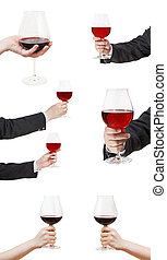 set od red wine glasses in hand isolated on white background