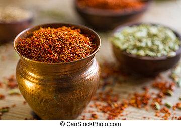 Saffron - Small copper pot containing a precious spice:...