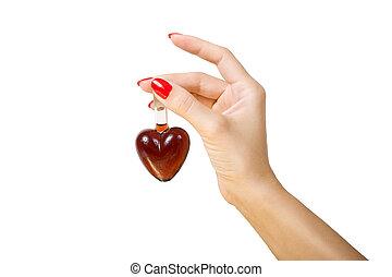 elixir of Love (love spell) - female hand holding elixir of...