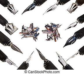 many nib pens in wooden holders close up isolated on white...
