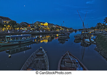 Twilight at the river bank in ancient town of Hoi An,...