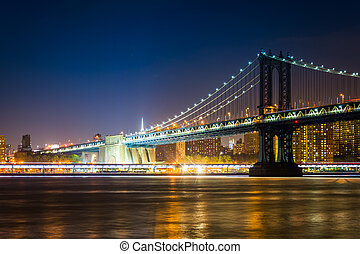 Manhattan Bridge at night, seen from Brooklyn Bridge Park,...