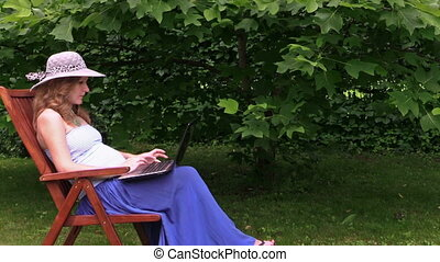 girl belly work laptop - nice pregnant woman with grey hat...