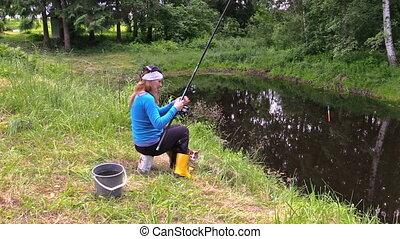 gir angler fishing in rural pond, h