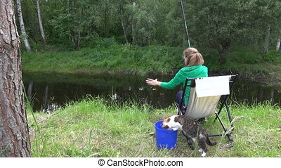 woman fish cat - Woman catch crucian fish and let it in...