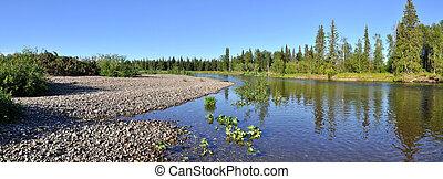 Panorama pebbly shore taiga river. River Polar Urals sunny...