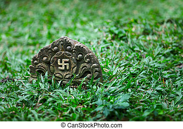 Tombstone with the image of ancient symbol - the swastika...