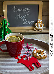 Christmas time - Red ceramic cup with tea and lemon, Happy...