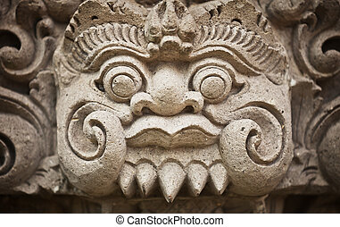 Face of the ancient deities carved in stone. Indonesia, Bali