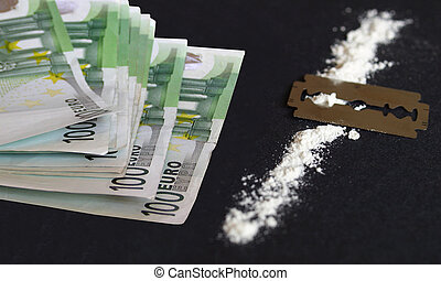 Cocaine drug - Cocaine, razor blade and money (simulation...