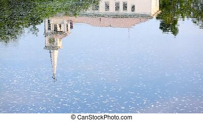 The reflection of a church steeple