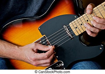Guitar Player - Playing and bending string on electric...