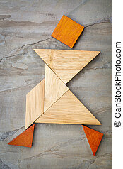 tangram walking figure - abstract of a dancing or walking...