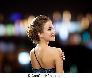 smiling woman in evening dress - people, holidays and...