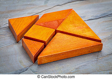seven tangram puzzle pieces - seven tangram wooden pieces, a...