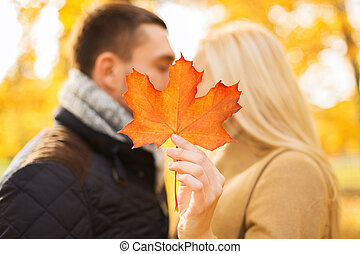 close up of couple kissing in autumn park - love,...