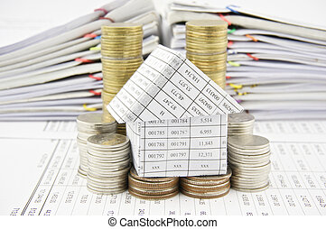 House on pile gold and silver coins place on finance account...
