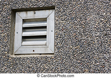 Louvered vent - A louvered vent on a pebble textured wall.