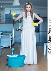 Stern Woman Wearing Gown and Holding Mop - Stern Looking...