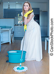 Woman Wearing Gown Mopping Floor in Kitchen - Woman Wearing...