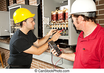 Repairing Power Distribution Center - Electricians working...