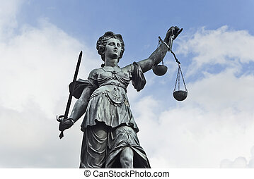 Justizia - Statue of Justice with sword and scales in front...