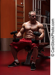 Young Man Working Out Biceps - Young Bodybuilder Working Out...