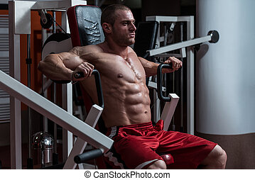 Young Bodybuilder Doing Heavy Weight Exercise For Chest -...