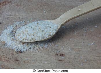 Medicinal Isabgol or psyllium husks with a spoon