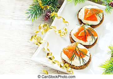canape with salmon and cream cheese with dill for Christmas...